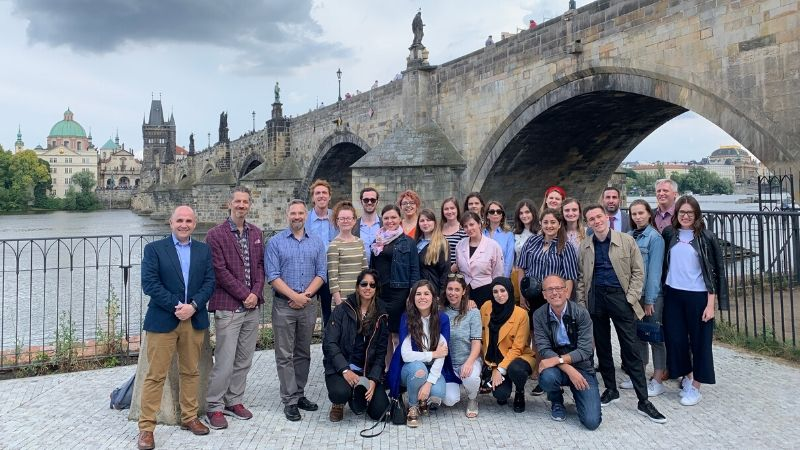 European Journalism Institute faculty and staff in front of the Charles Bridge.