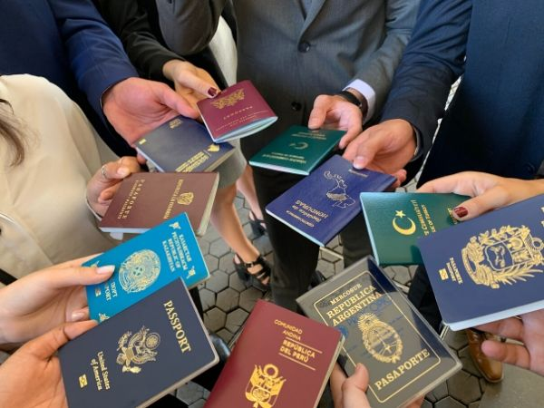 TFAS International participants fan out their passports, representing many different countries.